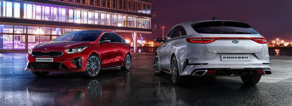 red and silver kia proceed
